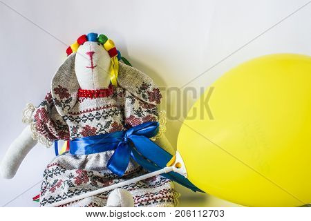 The Doll Is A Guard In A National Costume With Ribbons And A Yellow Ball.