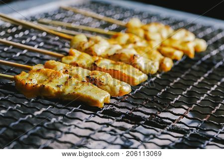 Pork satay skewer grill on charcoal stove.