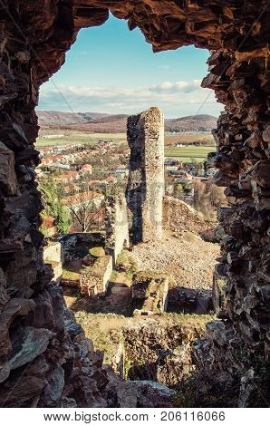 View from the ruins of Divin castle Slovak republic. Travel destination. Vertical composition. Retro photo filter. Ancient architecture.