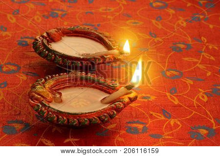 Two Beautiful Lit Diya for Diwali Celebrations