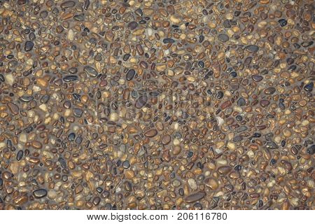 small round stone rock pebble wall floor texture background