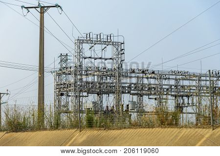 image of a transformer power station against the sky