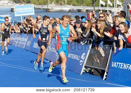 STOCKHOLM - AUG 26 2017: Running triathletes Blummnefelt (NOR) and Le Corre (FRA) fighting to get the silver medal in the Men's ITU World Triathlon series event August 26 2017 in Stockholm Sweden
