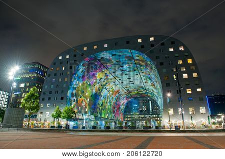 ROTTERDAM, NETHERLANDS - SEP 6, 2017: Modern Market Hall in Rotterdam at night. The Markthal is a residential and office building with a market hall underneath, located in Rotterdam.
