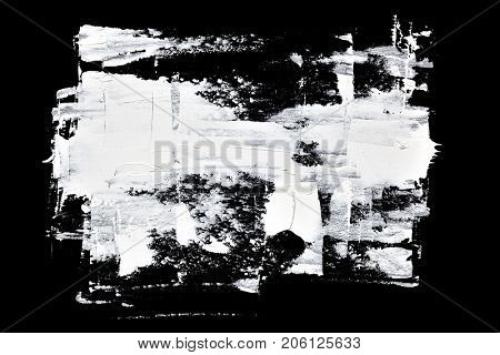 Brush strokes of white oil paint on black background - abstract composition