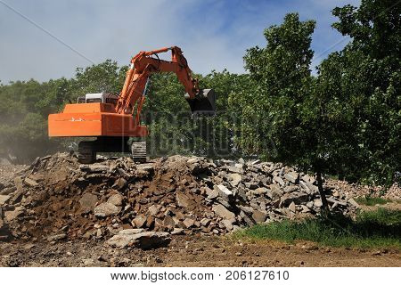 Stone crusher and crane in working in nature