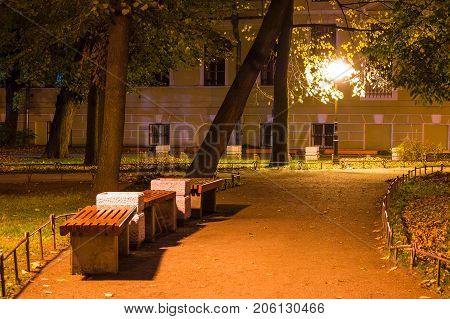 Night view of park and footpath with benches in Yusupov Garden Saint Petersburg Russia