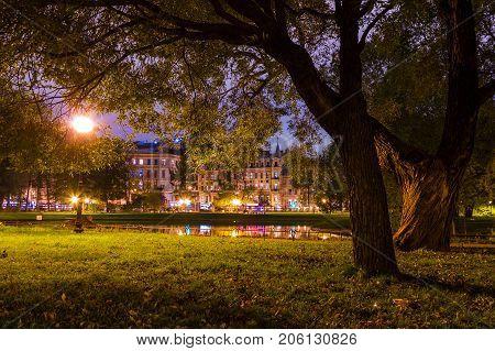Night view of park in Yusupov Garden and illuminated Sadovaya Street Saint Petersburg Russia