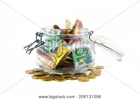 Euro cash in glass jar isolated