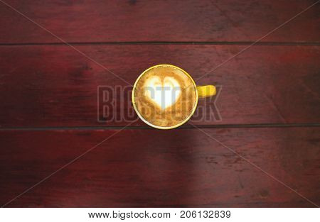 Mug Of Coffee On A Wooden Table.