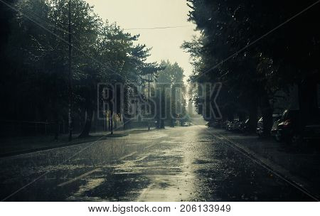Heavy autumn rain in small Balkan town weather moments.