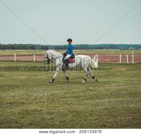 Middle-aged woman riding her horse