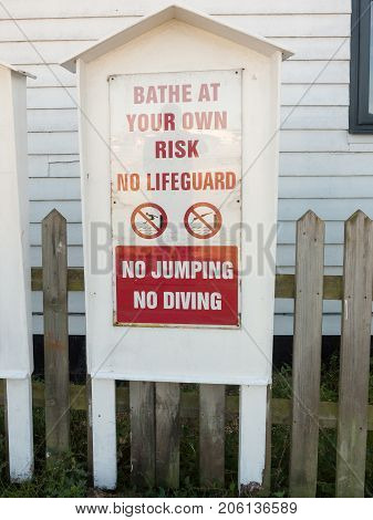 Bathe At Your Own Risk No Lifeguard No Jumping No Diving Warning Sign