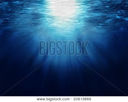 Underwater scene with sun-rays shining through the water's glittering
