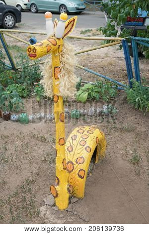 Giraffe made of secondary raw materials on playground