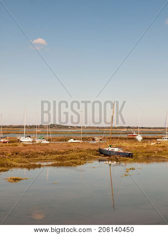Boats Parked In Stream River Estuary In Tollesbury Maldon Essex