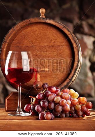 Red Wine.still Life With Glass Of Red Wine, Grapes And Barrel.selective Focus.copy Space