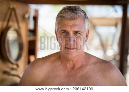 Portrait of man in cottage during safari vacation