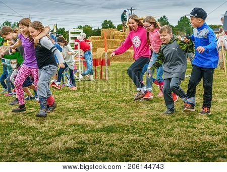 Summerside, PRINCE EDWARD ISLAND, CANADA - 17 Sept: Competitors race in a three legged race at Open Farm Day Sept. 17, 2017 in Summerside, Prince Edward Island.