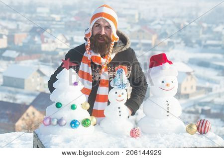 Man Opening Mouth With Snowy Sculptures