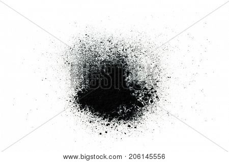 Black powder (Charcoal powder) scattered. Isolated on white background. A loose heap of fine Powdered charcoal.