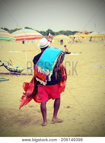 Abusive Walker Walking On The Beach Selling Cotton Fabrics