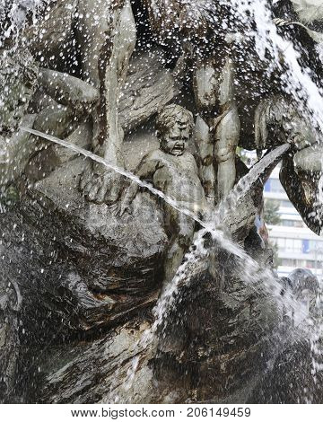 newborn statue crying in the midst of the water splash of Neptune's Fountain in BERLIN in GERMANY