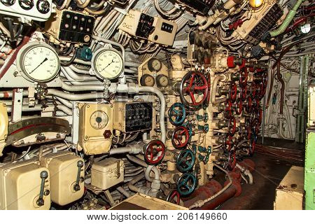 Interior of combat submarine compartment with devices of control.