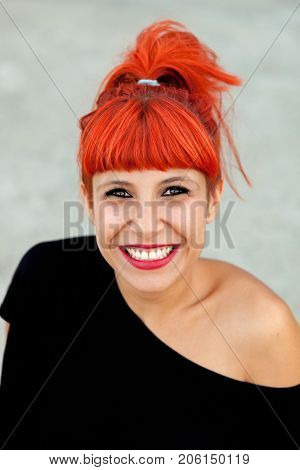 Portrait of a pretty red haired woman with black t-shirt