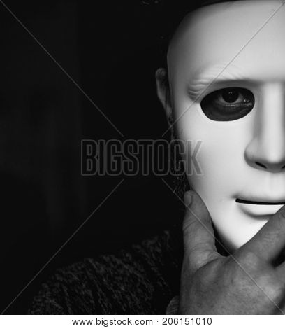 People holding a mask hiding