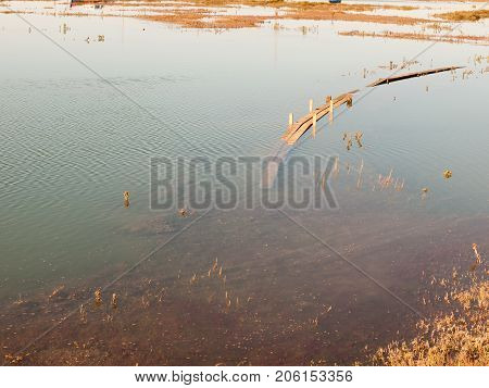 Submerged Wooden Walkway In Dockland In Sea Water