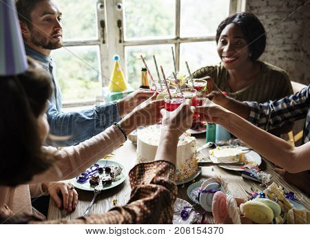 People Clinging Drinks Together on Birthday Party