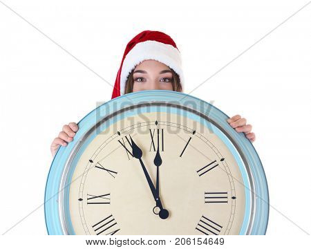 Young woman in Santa hat with clock on white background. Christmas countdown concept