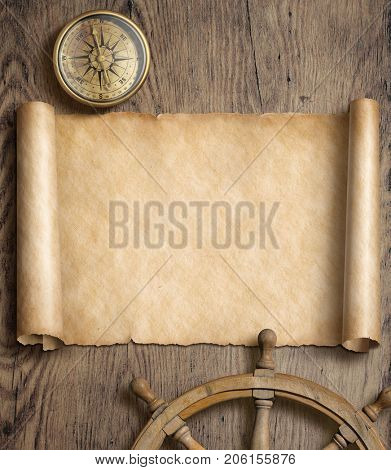 Old map scroll with compass and steering wheel on wood table. Adventure and travel concept. 3d illustration.