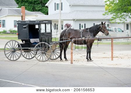 SHIPSHEWANA, INDIANA, USA - MAY 26, 2016: Amish horse and buggy in Northern Indiana's Amish Country, Shipshewana.