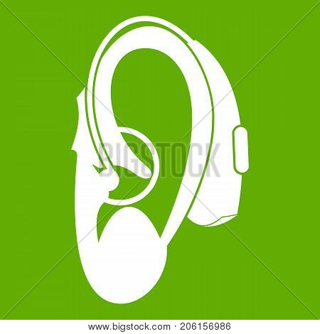 Hearing aid icon white isolated on green background. Vector illustration