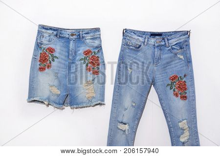 Embroidered flowers Torn Jeans with embroidered flowers skirt isolated