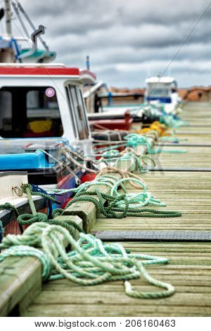 Mooring ropes along a jetty  in Havre Aubert in Quebec, Canada