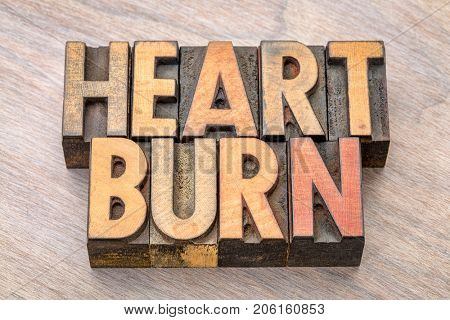 heartburn word abstract in vintage wood letterpress printing blocks