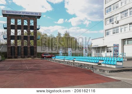 MOSCOW, RUSSIA - MAY 13, 2017: FAU DPO Moscow Training Center FPS Golubinskaya 6a. Inscription on fire tower: Fire-applied sport is sport of strong, deft, brave.