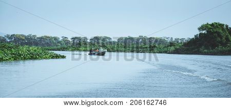 Boat Navigating On Waters Of Pantanal With Tourists Aboard