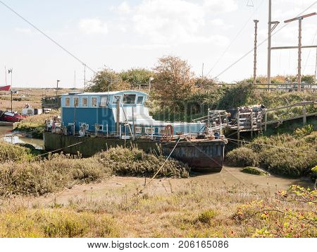 Parked Moored Big Boat In Dock Marshland