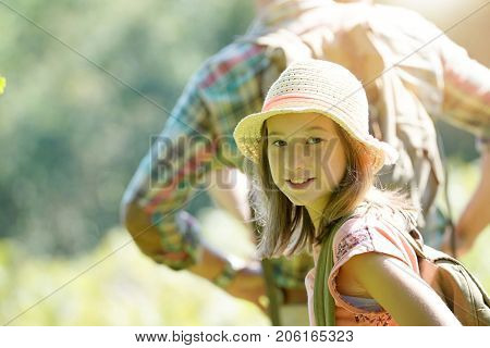 Portrait of young girl on a rambling day with parents