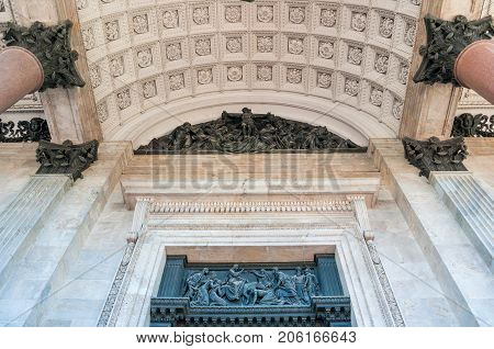 ST PETERSBURG,RUSSIA-AUGUST 15,2017.Architecture background. Colonnade capitals ceiling and sculptures of the St Isaac Cathedral in St Petersburg Russia. Architecture detailed view of St Petersburg landmark