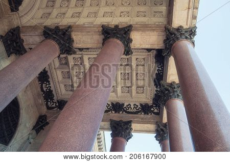 ST PETERSBURG, RUSSIA - AUGUST 15, 2017. St Isaac Cathedral colonnade in St Petersburg Russia. Architecture background with columns
