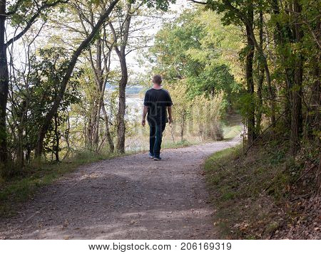 Man From Behind Walking Rambling On Footpath In Country