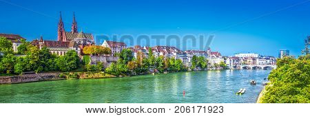 Old city center of Basel with Munster cathedral and the Rhine river Switzerland Europe. Basel is a city in northwestern Switzerland on the river Rhine and third-most-populous city.