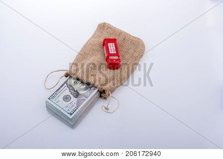Telephone booth and banknote bundle of US dollar in a sack