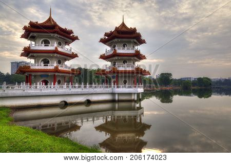 Twin Pagodas on a pond at Chinese Gardens which is part of Jurong Lake Gardens a public park in Singapore. The garden is modeled after the Chinese imperial style of architecture and landscaping. The public garden is maintained by the National Parks Board