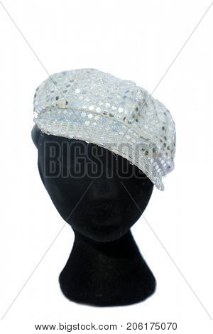 black mannequin with a fun fashion hat. isolated on white. room for text.